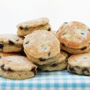 Traditional welsh cakes piled on a table. with a blue checkered tablecloth